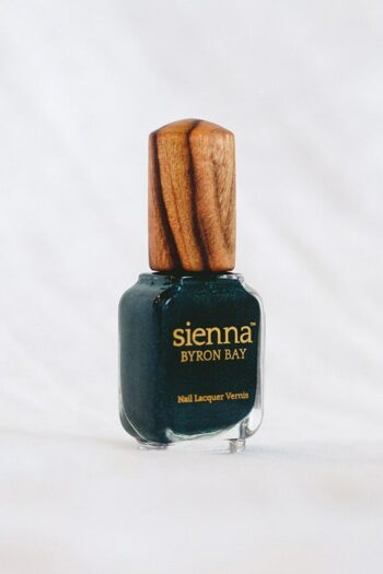 dark aqua shimmer nail polish glass bottle with timber cap by sienna