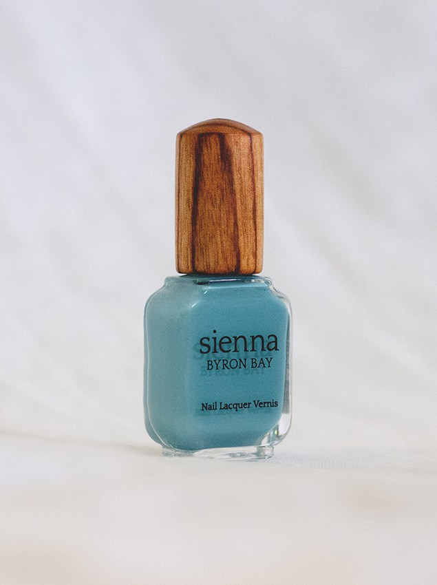 mid-tone blue nail polish glass bottle with timber cap by sienna