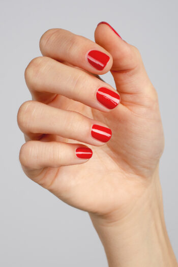 apple red nail polish hand swatch on fair skin tone by sienna