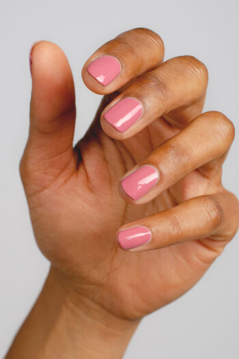 pink nail polish hand swatch on medium skin tone by sienna
