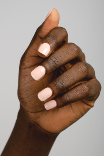 pastel pink nail polish hand swatch on dark skin tone by sienna