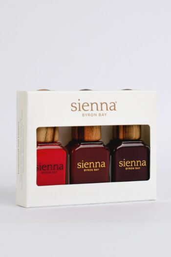 3 red nail polishes in white box by sienna