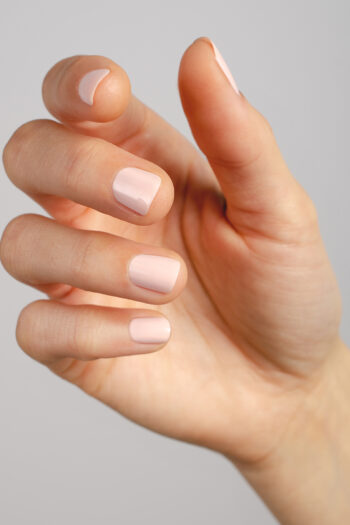 light pastel pink nail polish hand swatch on fair skin tone by sienna