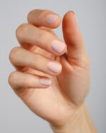 light nude pink nail polish hand swatch on fair skin tone by sienna