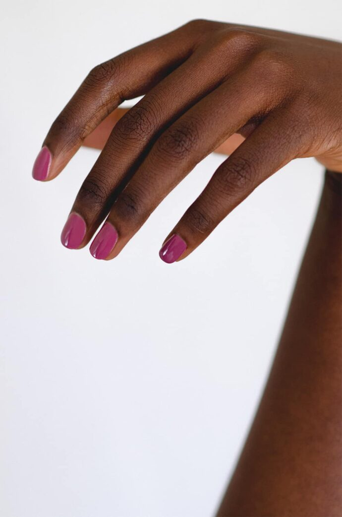 Dark Rose nail polish on dark skin tone