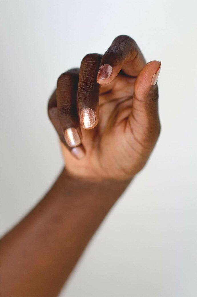 rose gold nail polish on dark skin tone