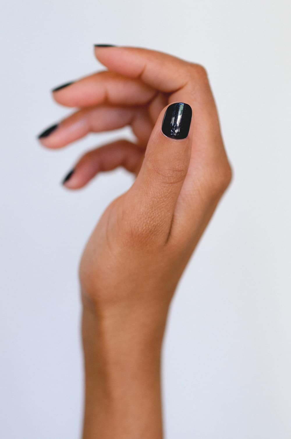 black nail polish on medium skin
