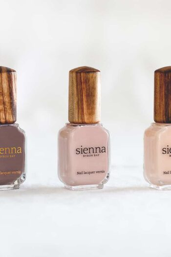 three nude neutral nail polish in glass bottle with timber cap by sienna