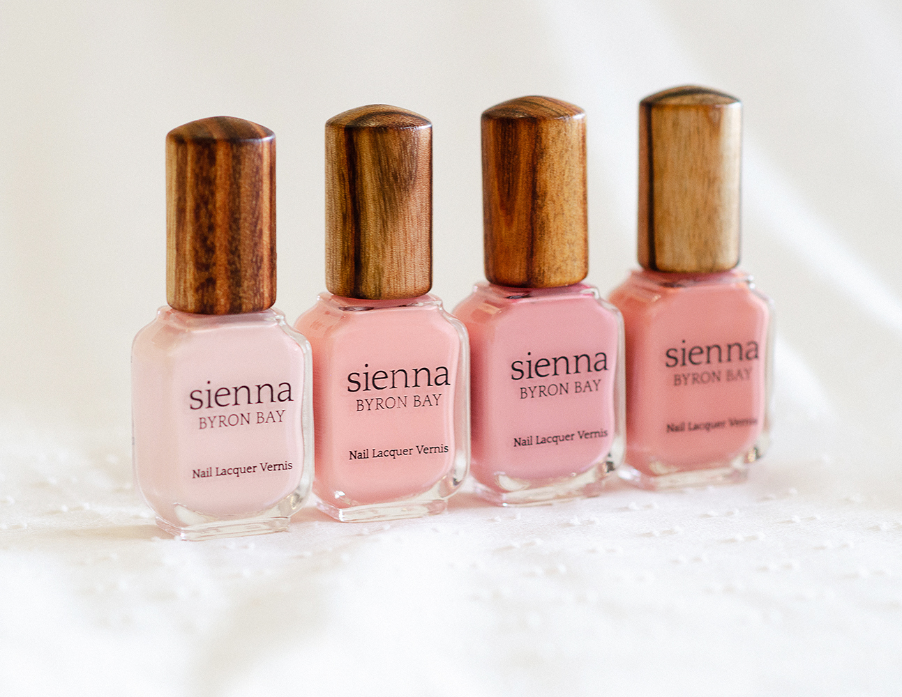 light pink nail polish bottles with timber cap by sienna
