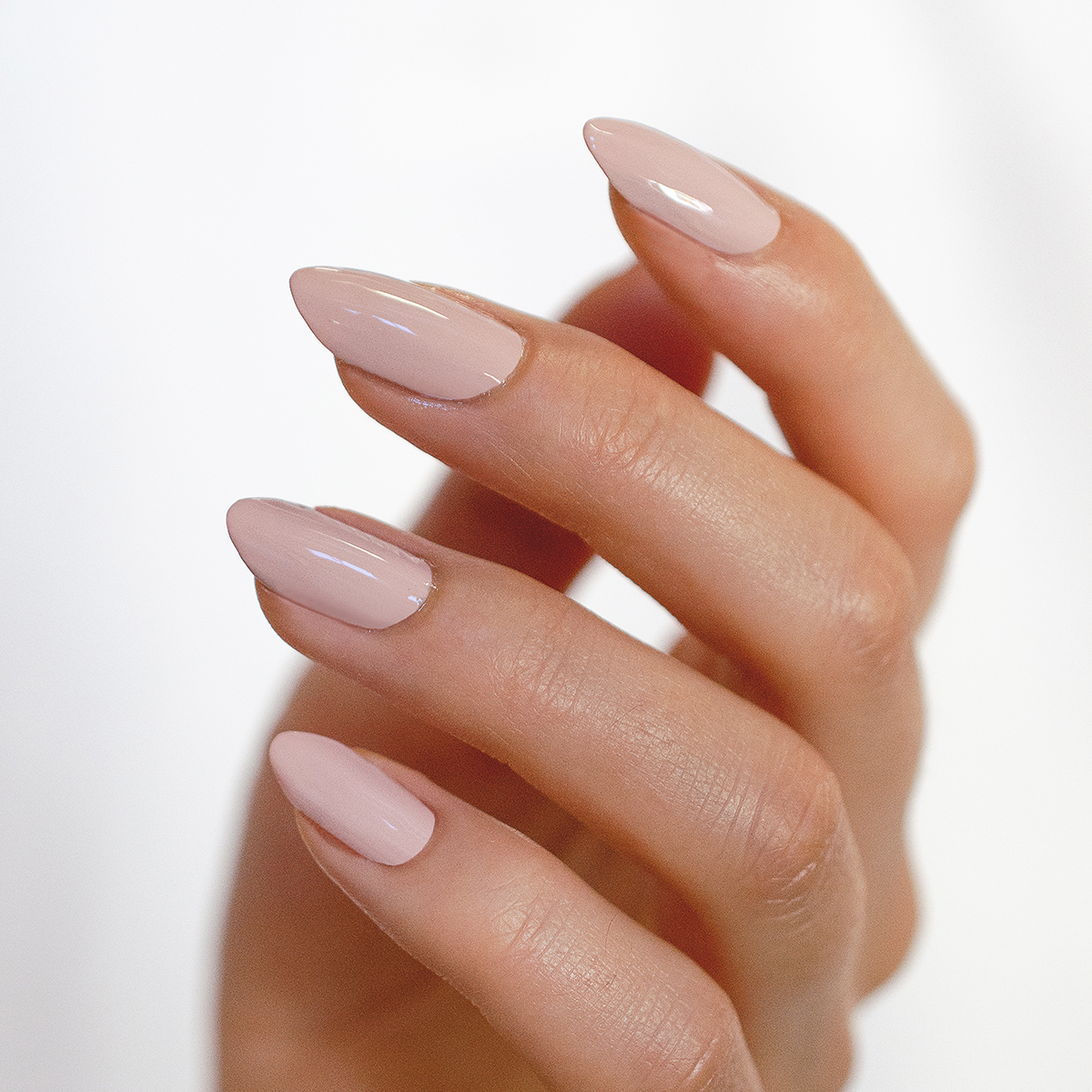 almond shape nails with nude nail polish by sienna