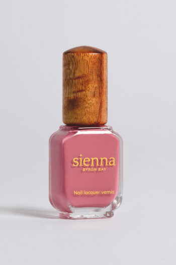 pink nail polish bottle with timber cap by sienna