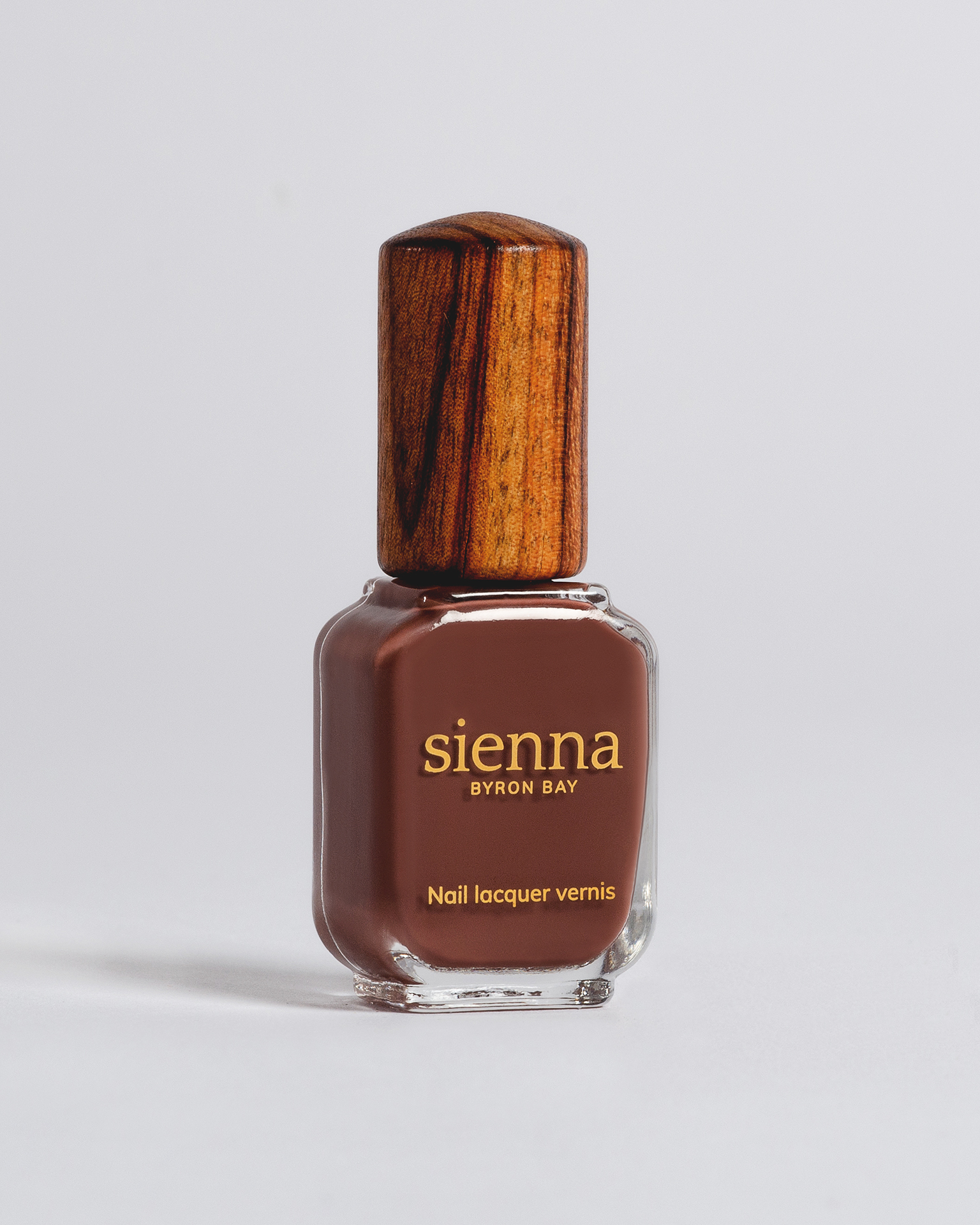 brown nail polish bottle with timber cap by sienna