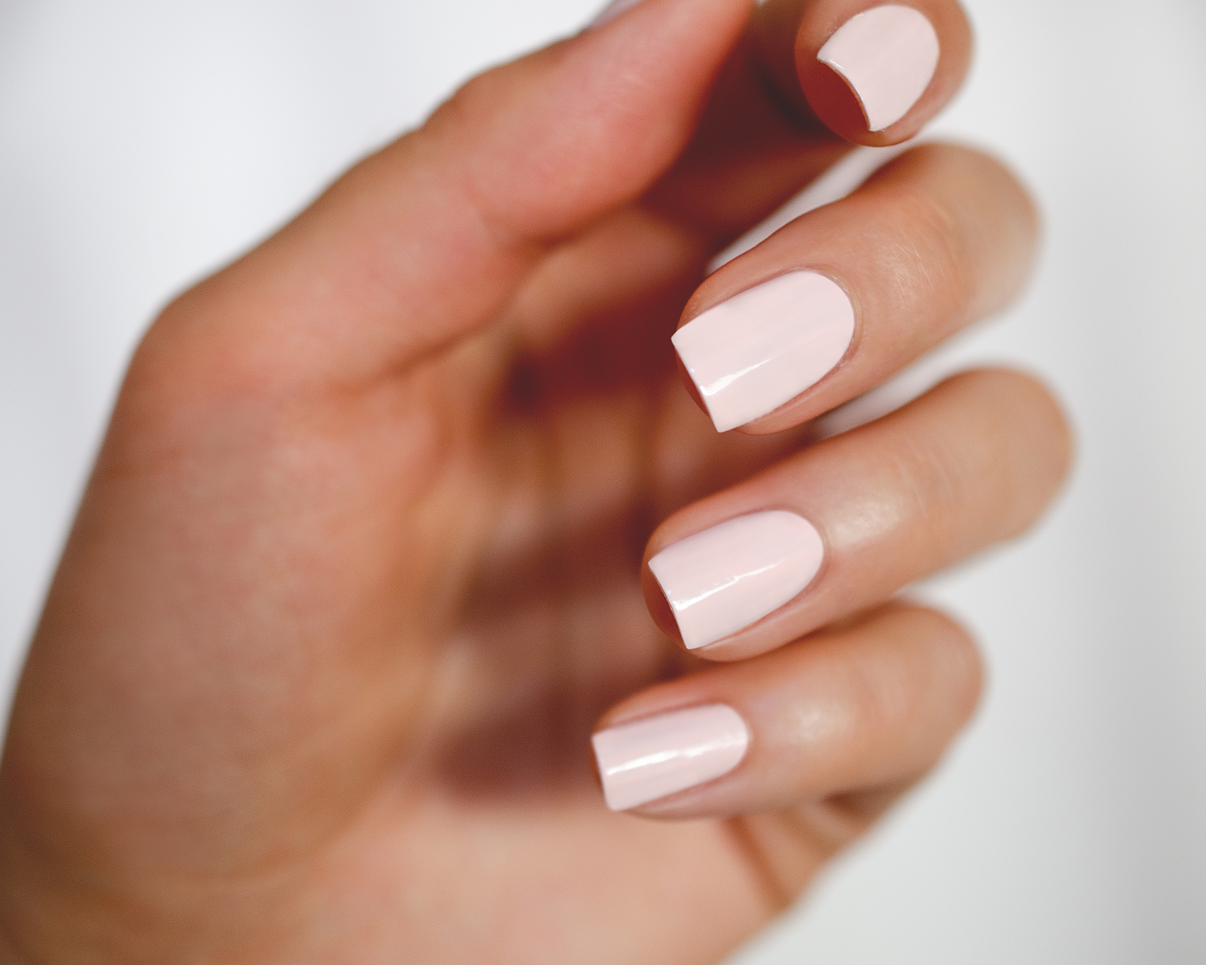 square nail shape with light pink nail polish by sienna