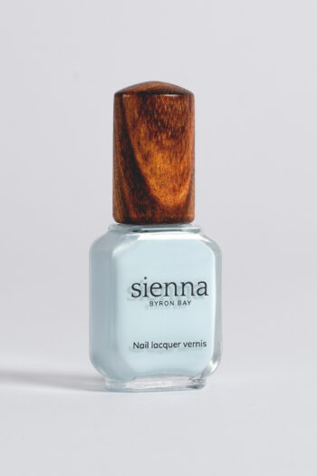 pastel blue nail polish bottle with timber cap by sienna