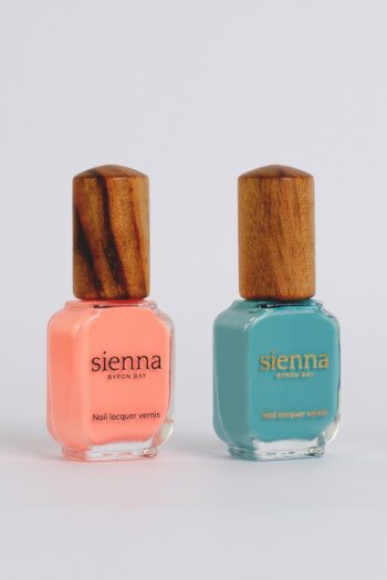 peach and aqua blue nail polish bottles with timber cap by sienna