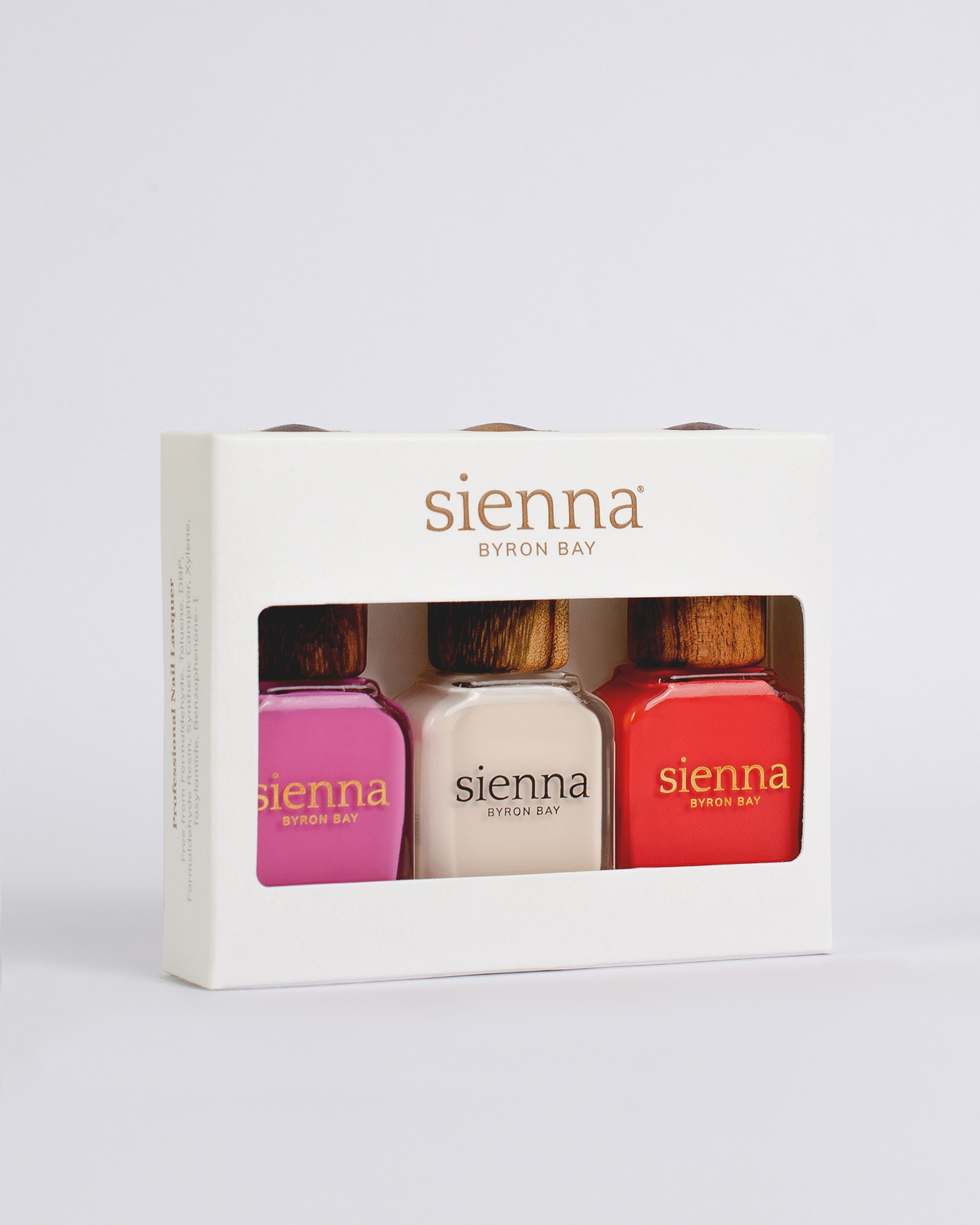 3 bright nail polishes in white cardboard box by sienna