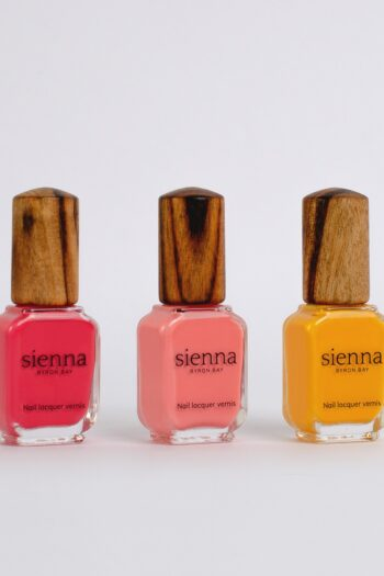 bright pink and yellow nail polish bottles with timber cap by sienna