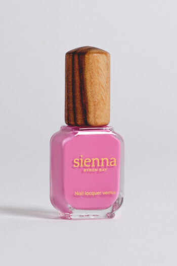 fushia nail polish bottle with timber cap by sienna