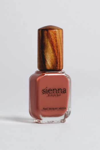 brick red nail polish bottle with timber cap by sienna