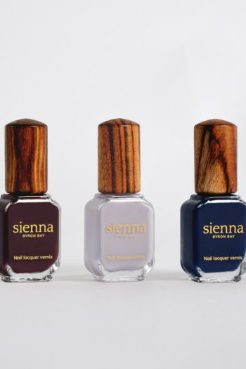 beige orange and brown nail polish bottles with timber cap by sienna
