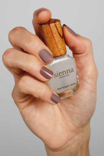 neutral mauve nail polish hand swatch with matte top coat on fair skin tone by sienna