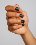 black nail polish hand swatch with matte top coat on medium skin tone by sienna