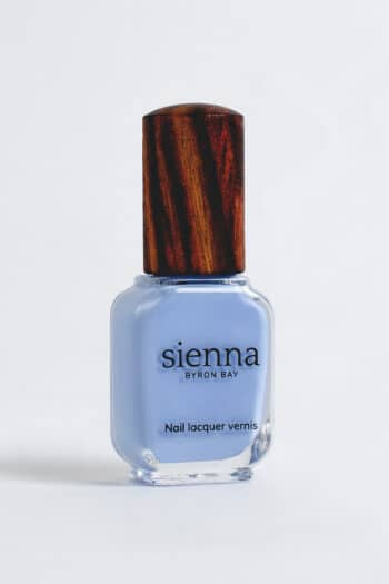 Baby blue nail polish bottle with timber cap by Sienna